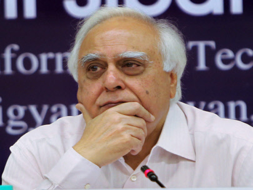 Sibal for hiring best scientists at desired pay scale