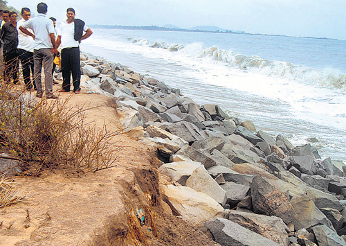 Woman washed away in M'lore