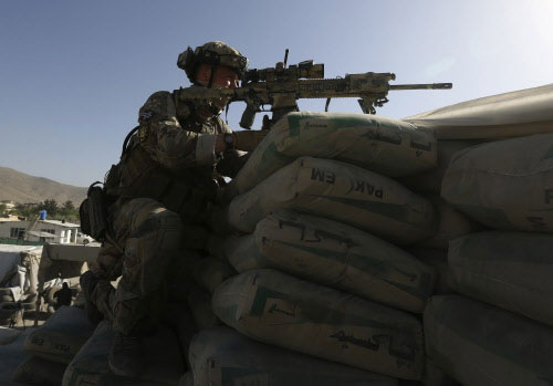 NATO hands over security to Afghans