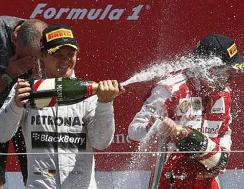 Rosberg triumphs in Britain after Vettel retires