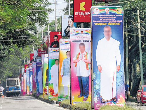 Clear ad policy, lifting ban can check illegal hoardings