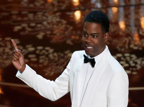 Chris Rock makes his Oscar opener political, talks racism
