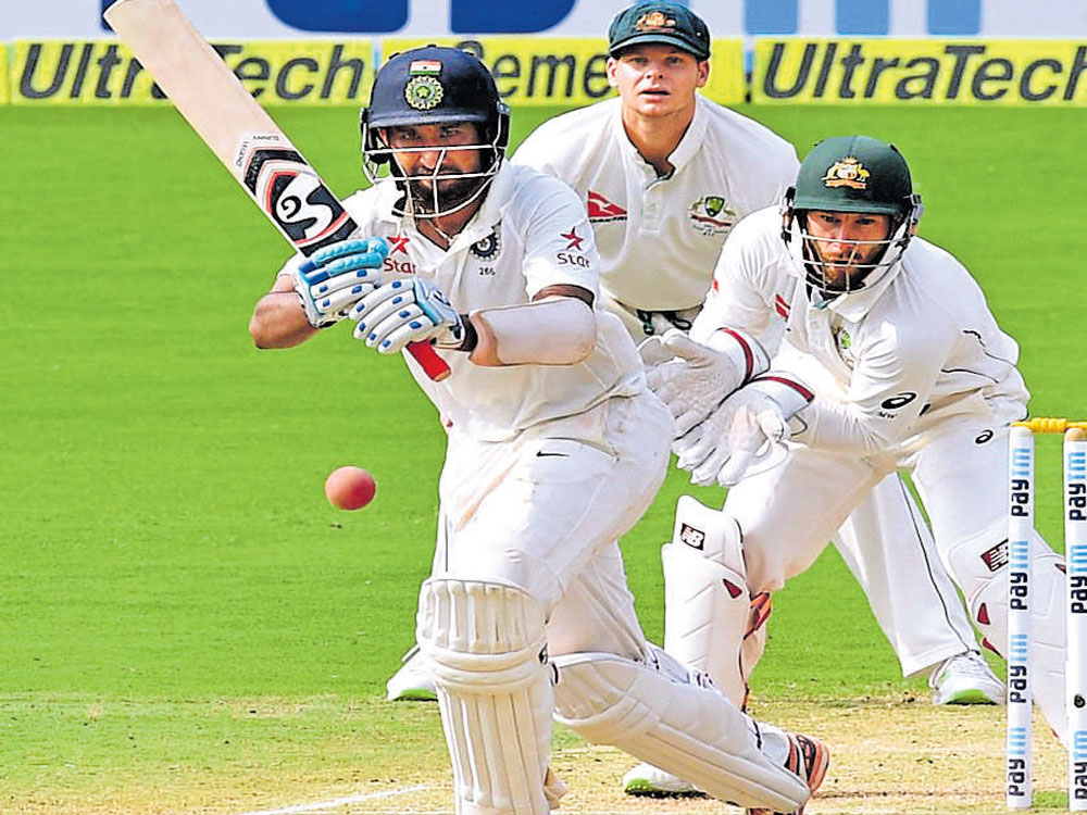 India battle to stay afloat