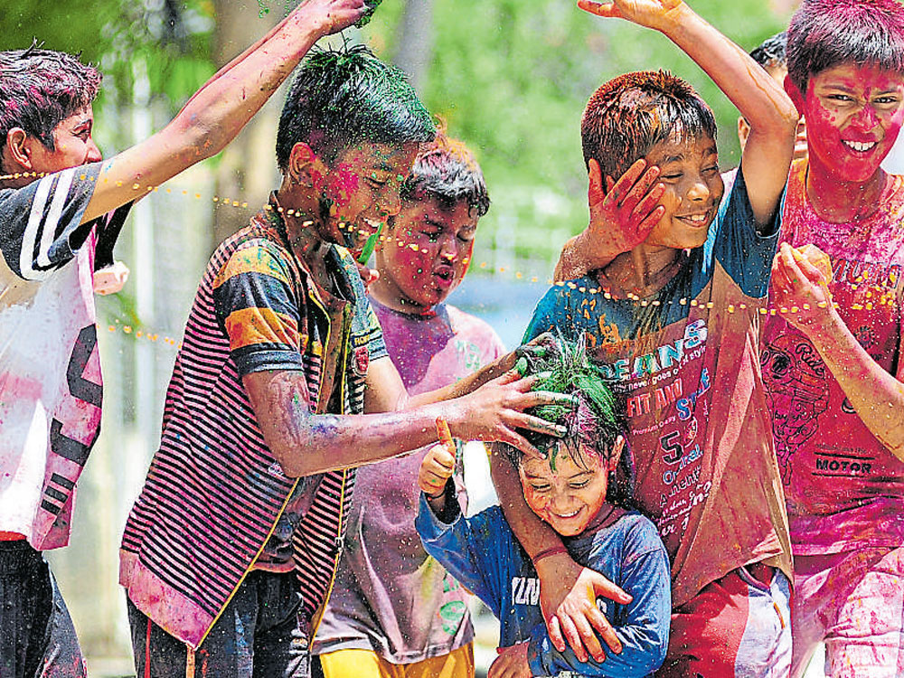 Colours, culture, camaraderie mark Holi in city on Sunday