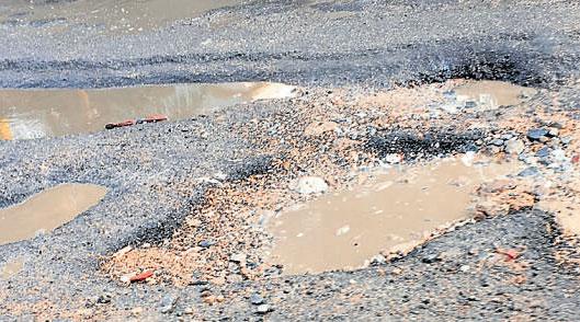 People's problems- Koramangala-Ejipura road full of potholes