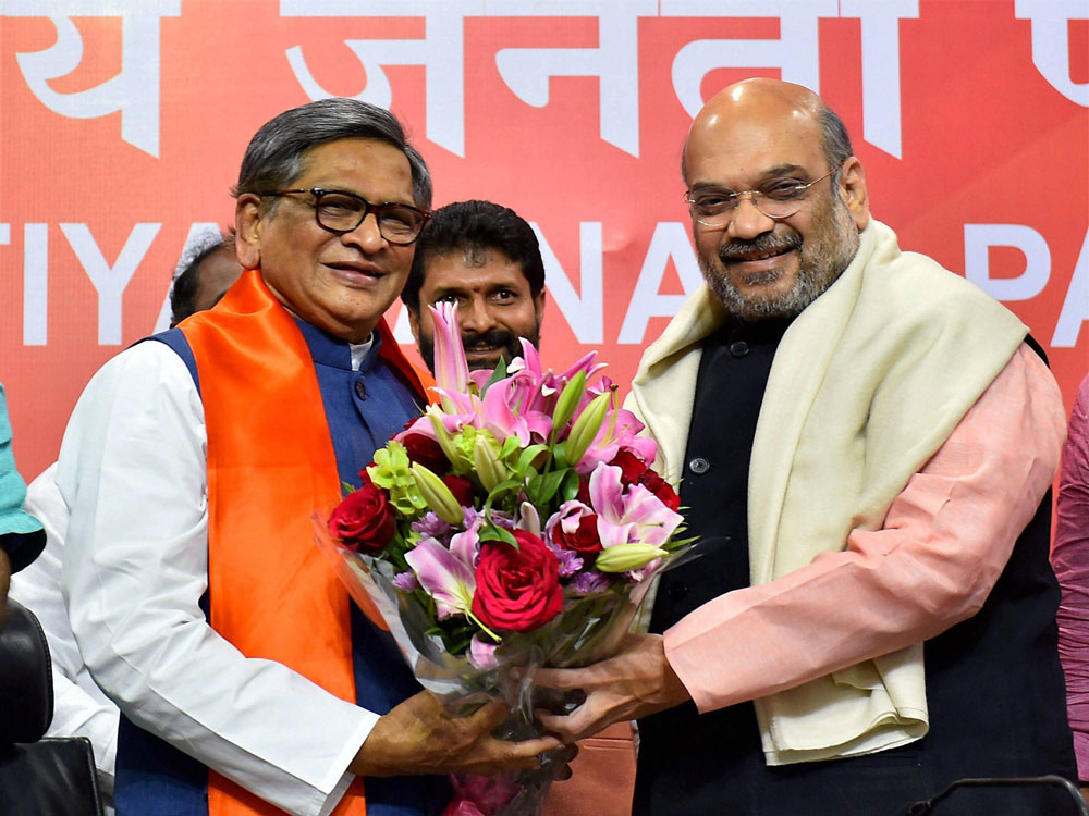 Krishna joins BJP, Shah says will honour seniority