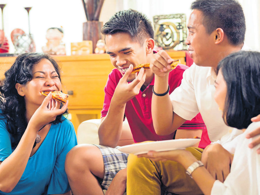 Cooking at home, skipping TV during meals may cut obesity risk