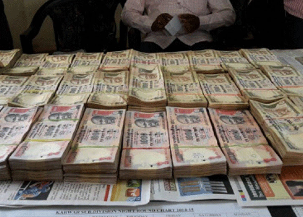Four arrested with Rs 4.98 crore in banned currency