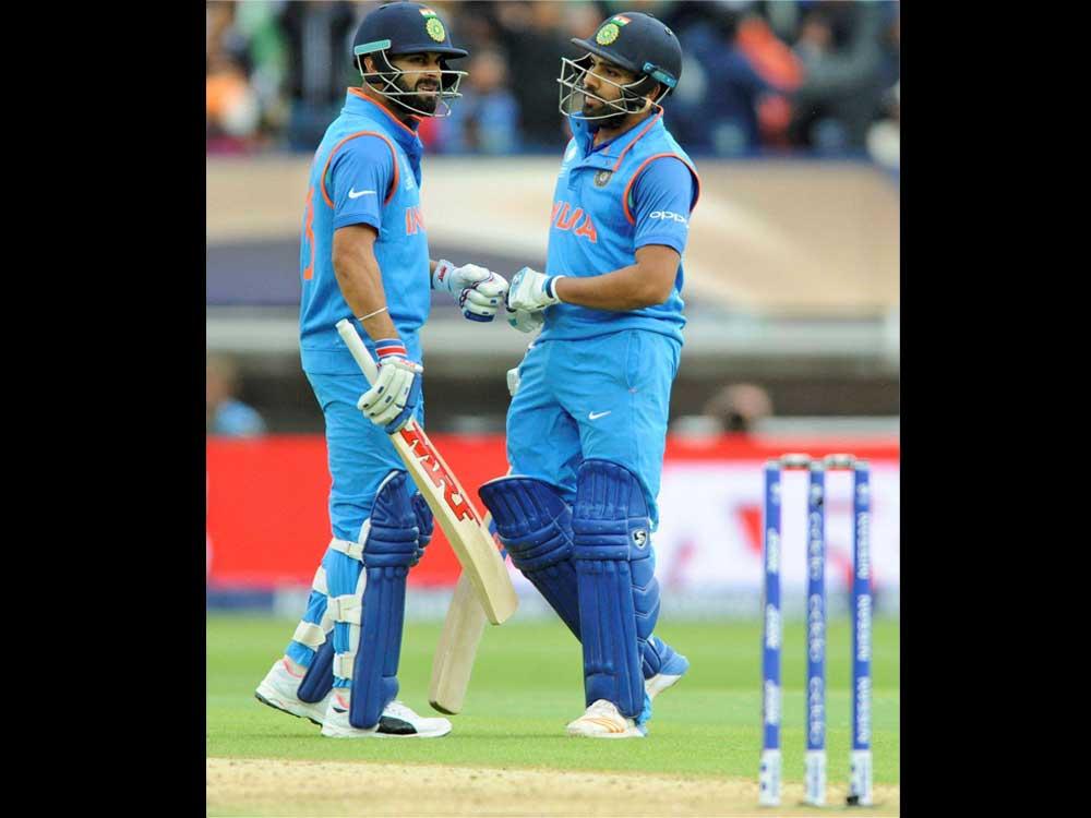 Kohli, Yuvraj fire India to 319/3 in rain-hit tie