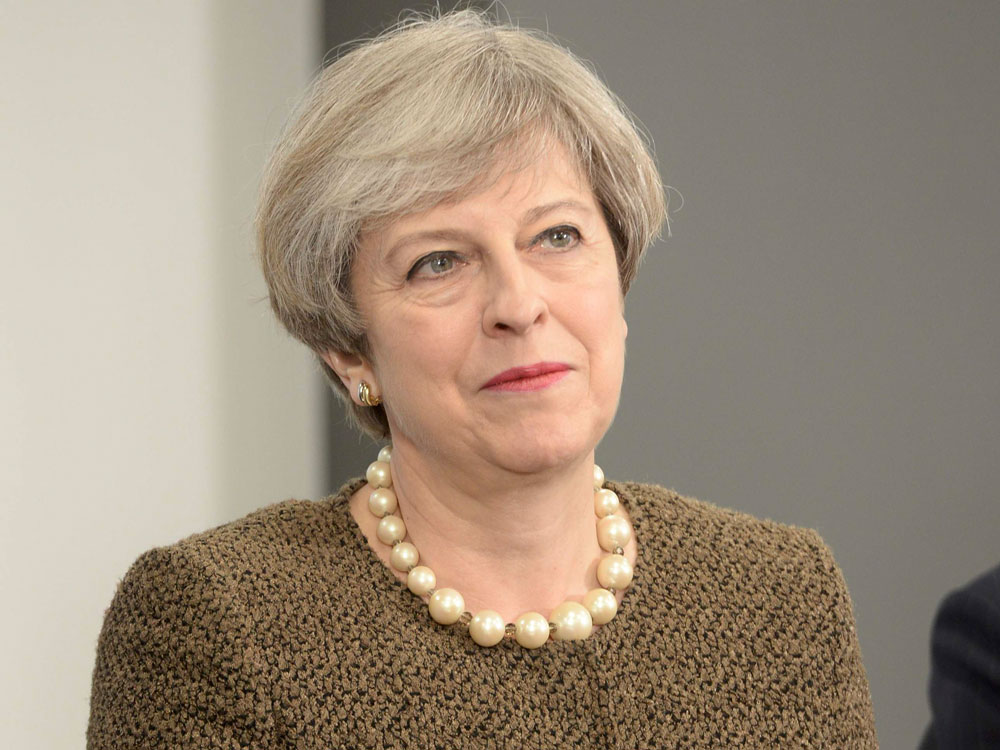 May finalises cabinet amid minority govt talks with DUP