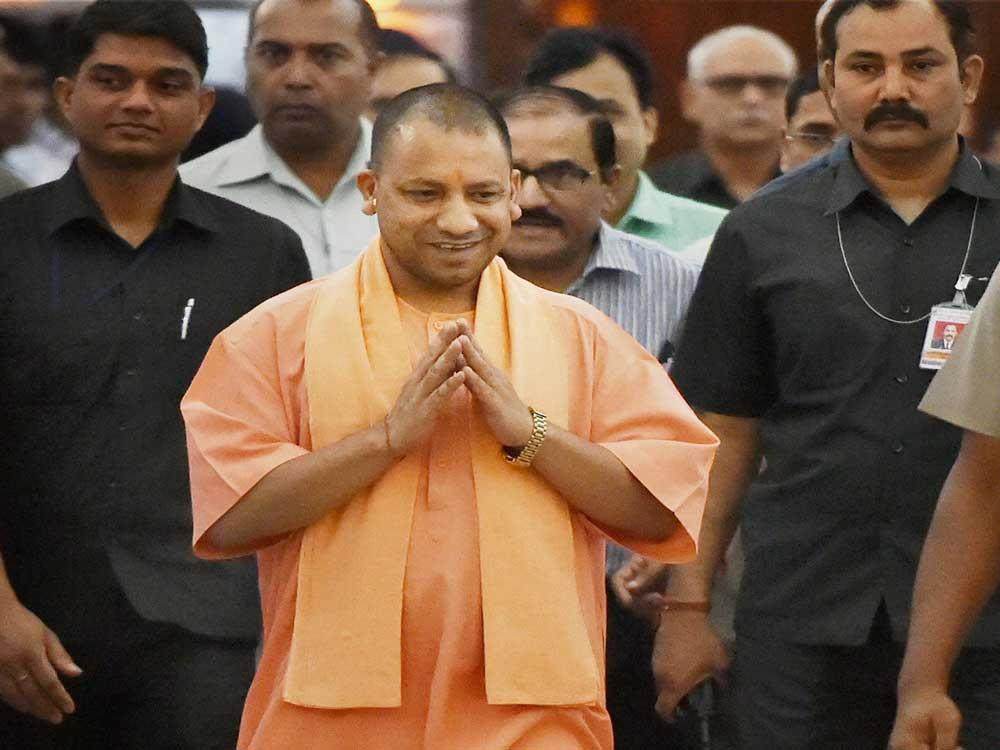 Yogi dines with dalits, heaps praise on Ambedkar