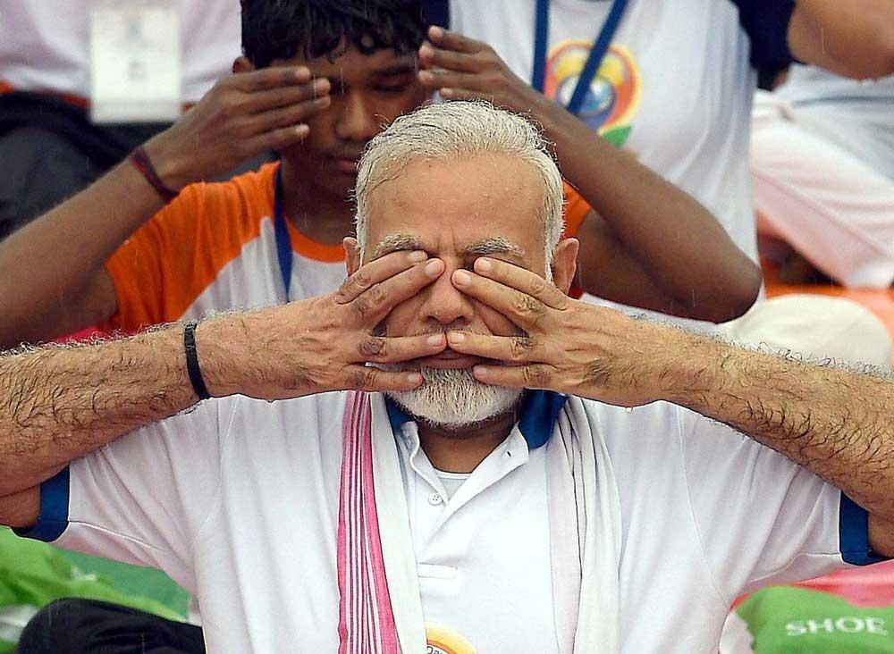 Yoga as important as salt, says Modi