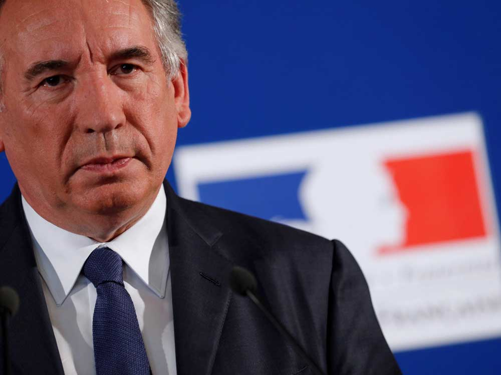 Key Macron ally says he is quitting French government