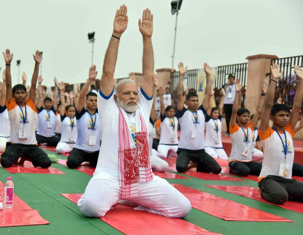 Showers fail to dampen enthusiasm of yoga participants
