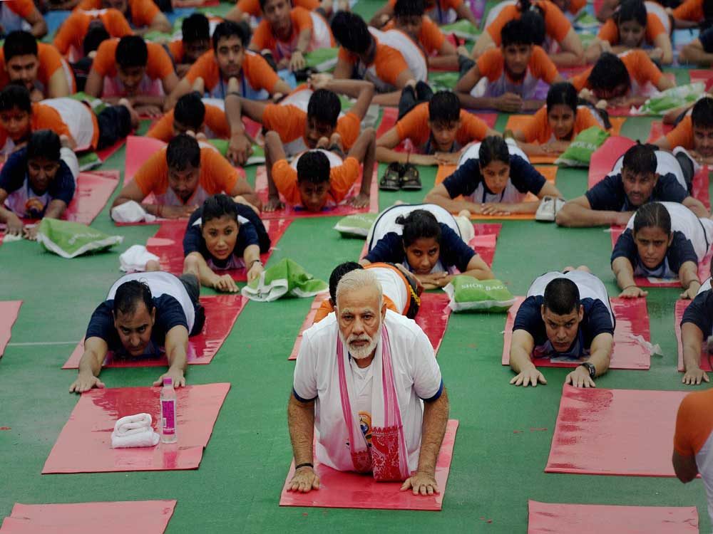 People take away mats from PM's Yoga program