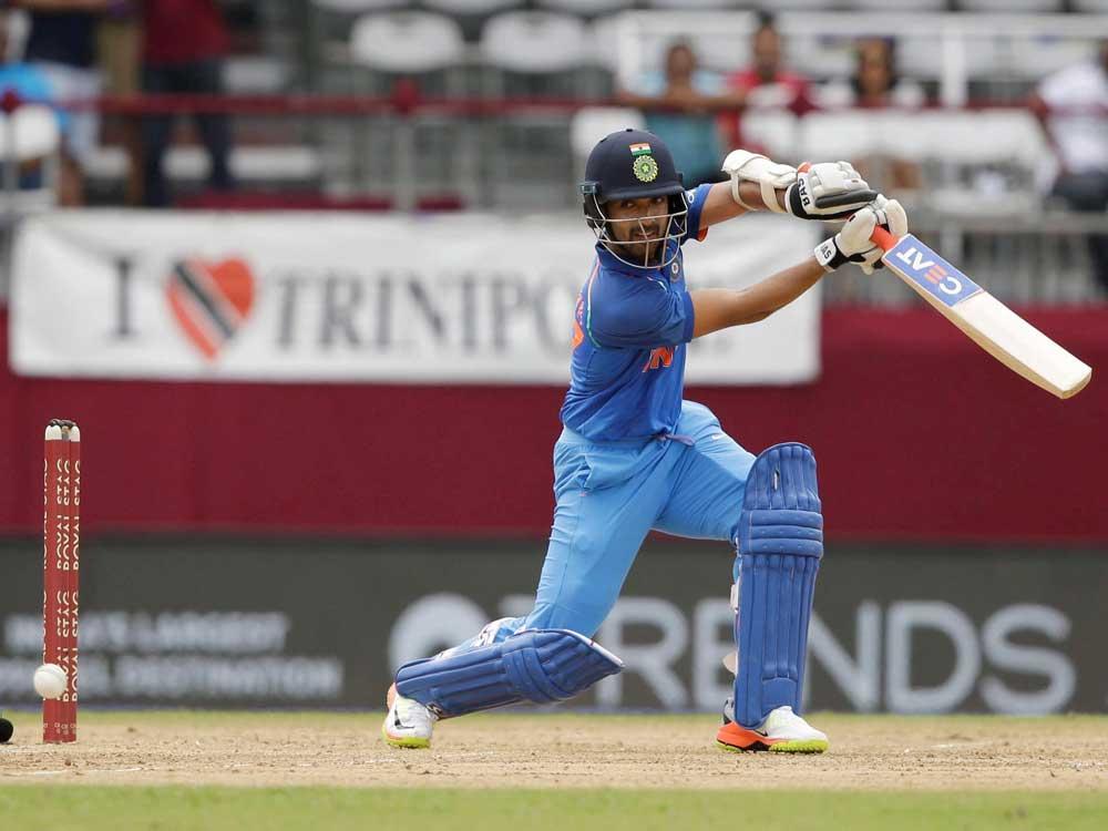 Rain plays spoilsport after Dhawan's 87, India 199/3