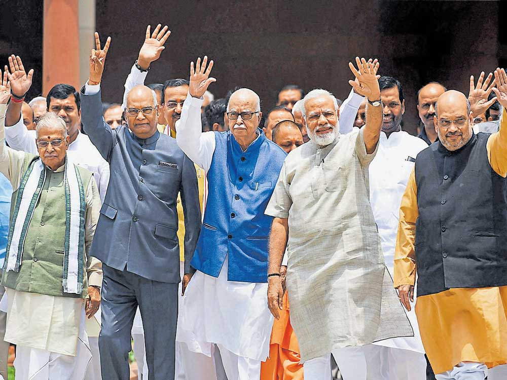 In PM's presence, Kovind files papers