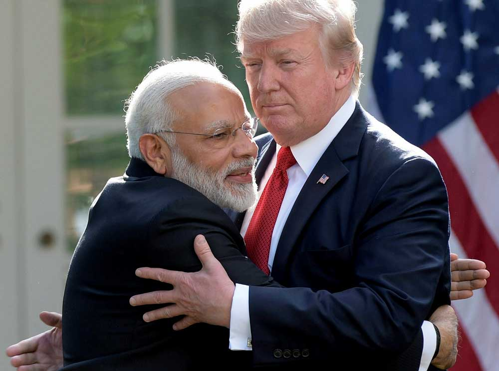 Modi and Trump strike rapport with hugs, praise