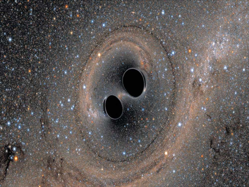 Orbiting supermassive black holes discovered for first time