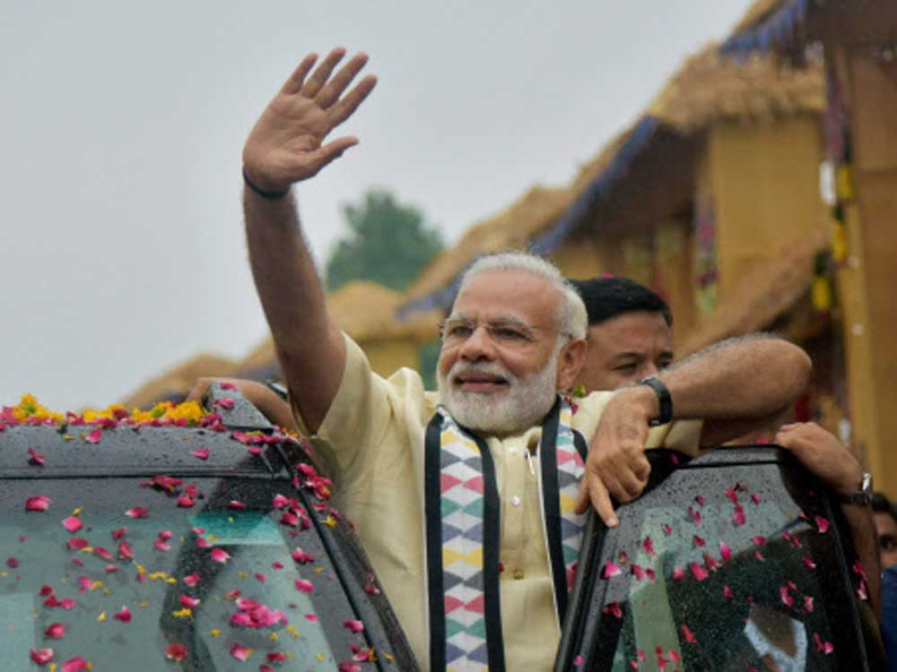 PM holds impressive roadshow in Rajkot