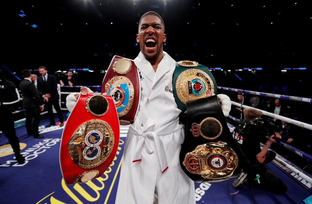 Joshua goes the distance before beating Parker in world heavyweight clash