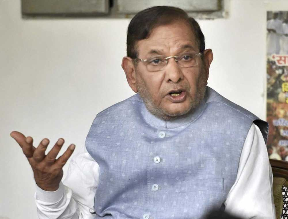 Modi govt must keep Manmohan Singh's promise to AP: Sharad Yadav