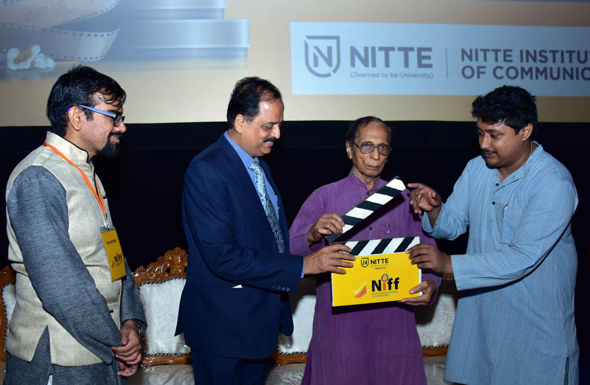 Filmmaker and theatreperson Sadananda Suvarna inaugurates 'NIFF', Nitte International Film Festival at Bharat Cinemas in Bharat Mall, Bejai, Mangaluru on Monday. Nitte (Deemed to be University) Vice Chancellor Dr Satheesh Kumar Bhandary, Coordinators Prof Raviraj and Dr Maitreya Deshpande look on. DH Photo