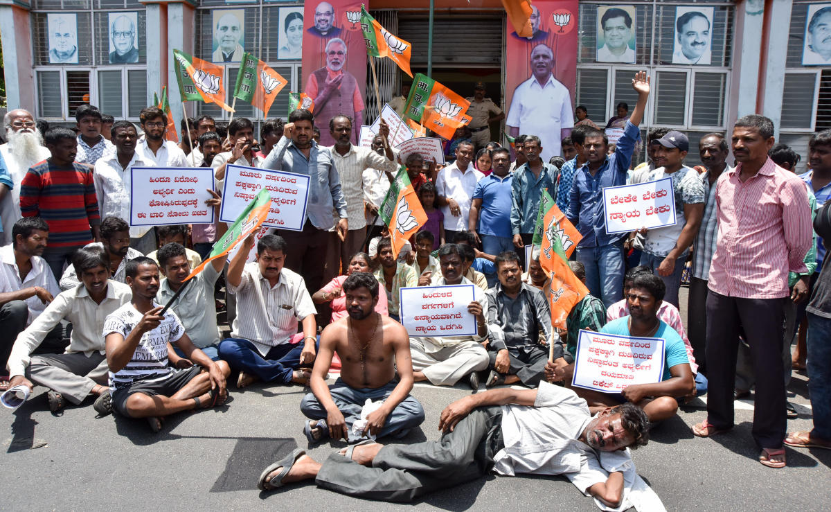 B M Nataraj's supporters stage a protest against not given the BJP ticket to B M Nataraj in Narasimharaja Constituency in front of BJP Office in Mysuru on Tuesday. Photo: Savitha B R