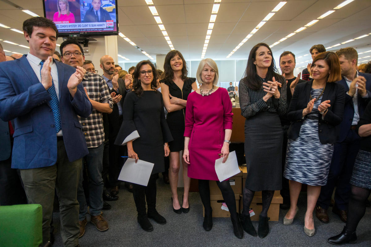 New York Times staff writers, 3rd L - R; Jodi Kantor, Megan Twohey, senior enterprise editor Rebecca Corbett and reporter Cara Buckley celebrate with colleagues in the newsroom after the team they led won the 2018 Pulitzer Prize for Public Service in New York, NY, U.S., April 16, 2018. (Courtesy Hiroko Masuike/The New York Times/Handout via REUTERS)