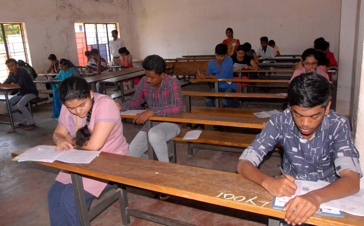 Students write CET exam at Government PU College, Bellor Road, in Chikkamagaluru on Wednesday.