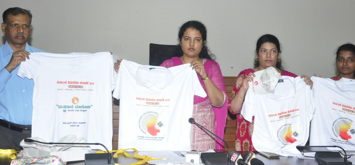 Udupi Deputy Commissioner Priyanka Mary Francis releasing T-shirts as a part of creating awareness on the importance of elections, in Udupi on Wednesday. DH photo