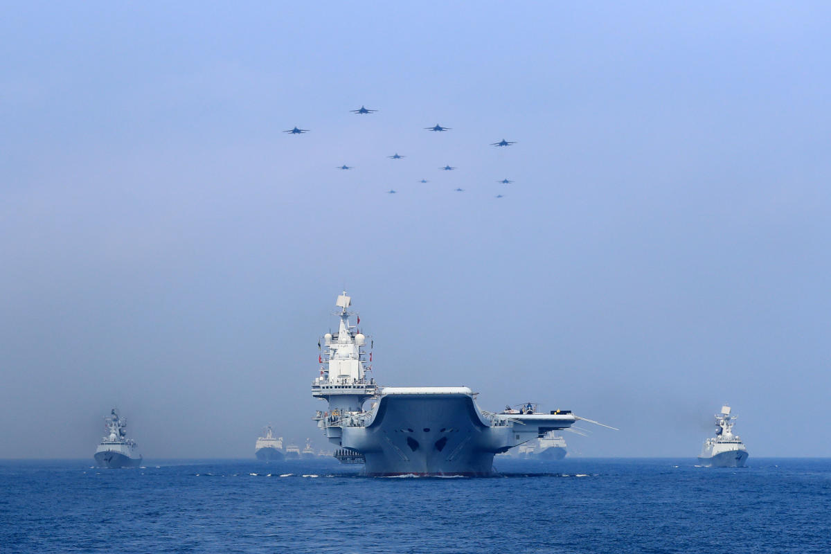 Chinese warships and jets on the South China Sea. Reuters file photo.
