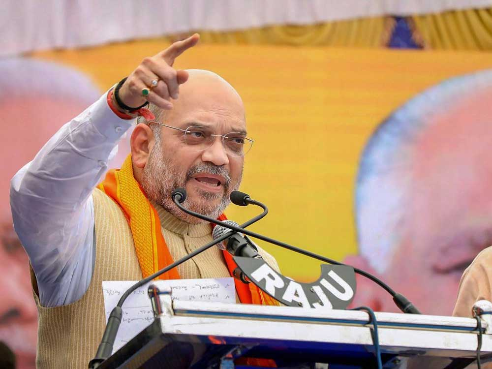 """In a blog released in counter to Congress' programme 'Save Constitution Day', Shah said if there was one political party post-independence that has """"trampled"""" upon the Constitution """"in letter and spirit, time and again, it is the Congress party"""". (PTI file photo)"""