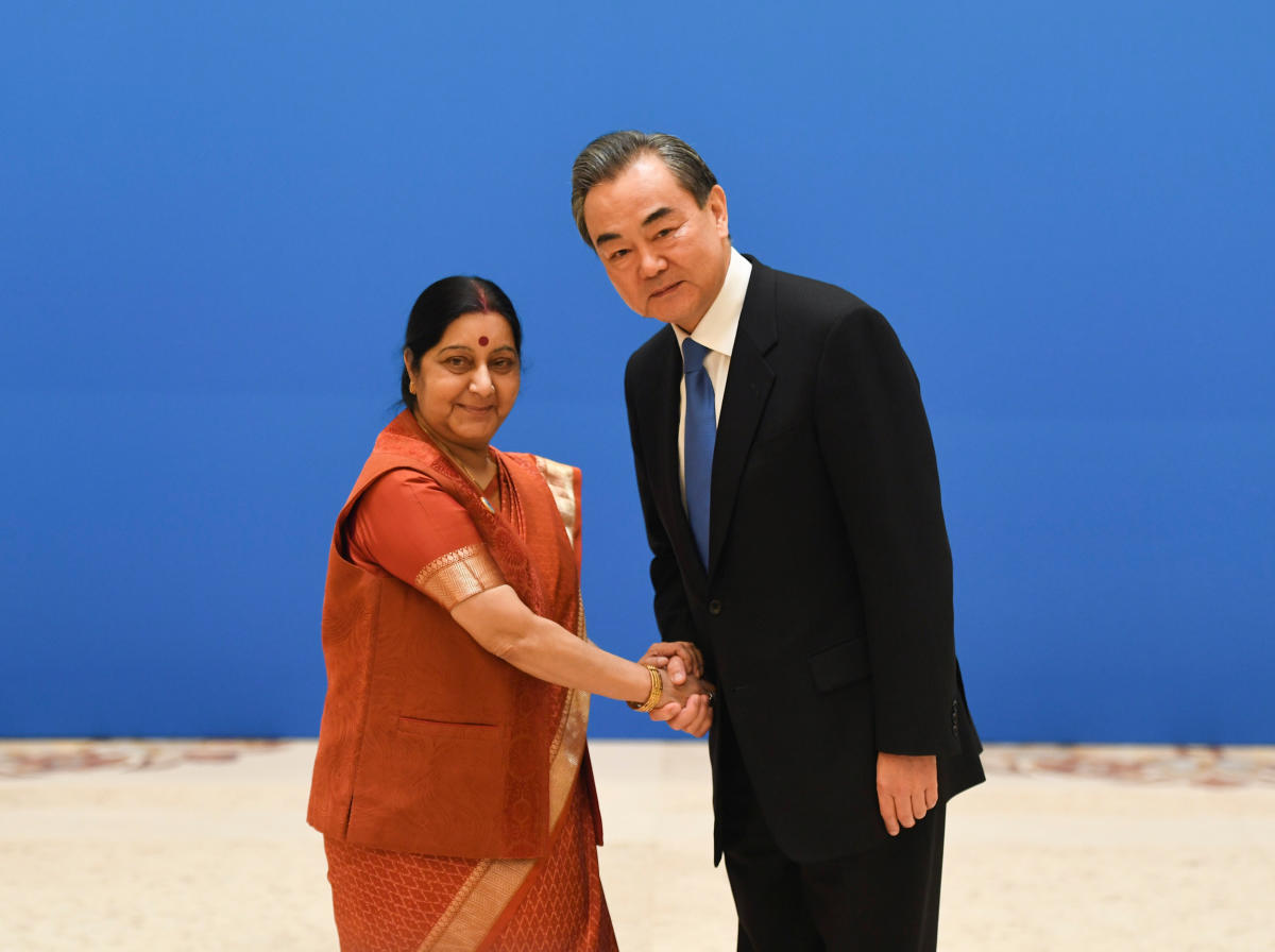 Indian Foreign Minister Sushma Swaraj (L) shakes hands with Chinese State Councilor and Foreign Minister Wang Yi before a meeting of foreign ministers and officials of the Shanghai Cooperation Organisation (SCO) at the Diaoyutai State Guest House in Beiji