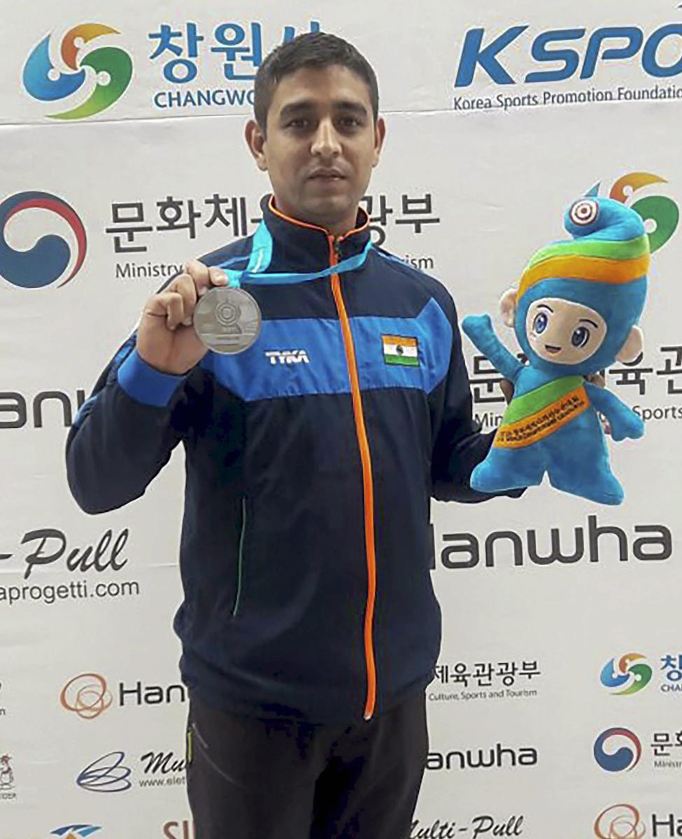 India's Shahzar Rizvi with his silver medal in the 10m air pistol event at the ISSF World Cup in Changwon, South Korea on Tuesday. PTI