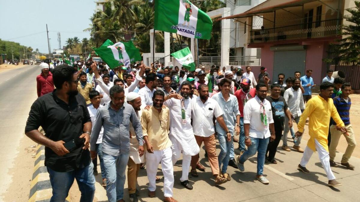 JD(S) candidate from Mangaluru K Ashraf take out a procession in Ullal before filing the nomination on Tuesday.