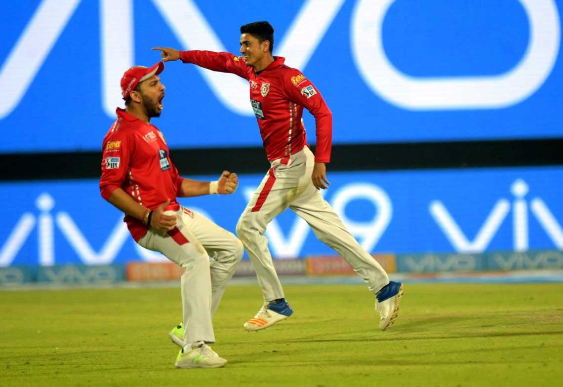 Kings XI Punjab cricketers cerebrate their victory against Delhi Daredevils during the IPL T20match at Ferozshah Kotla in New Delhi on Monday. PTI Photo