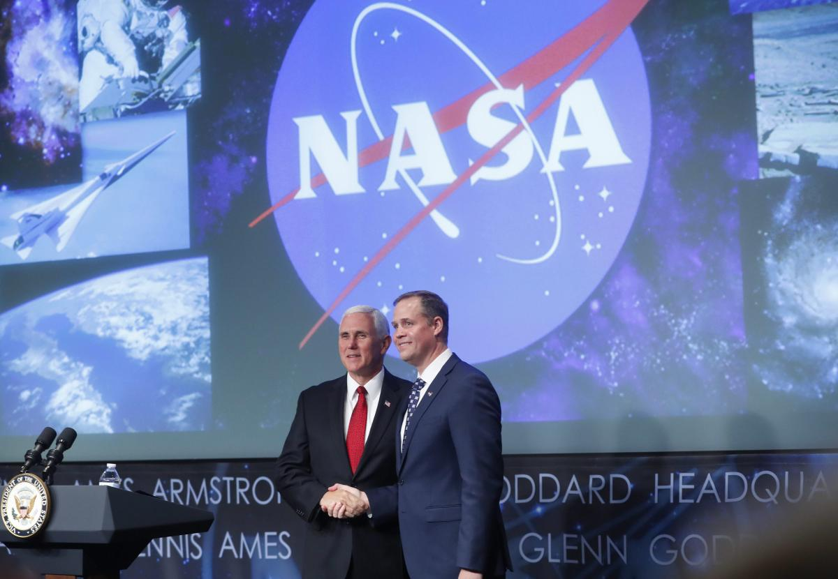 Vice President Mike Pence shakes hands with the new NASA administrator Jim Bridenstine at NASA Headquarters in Washington. AP/PTI Photo