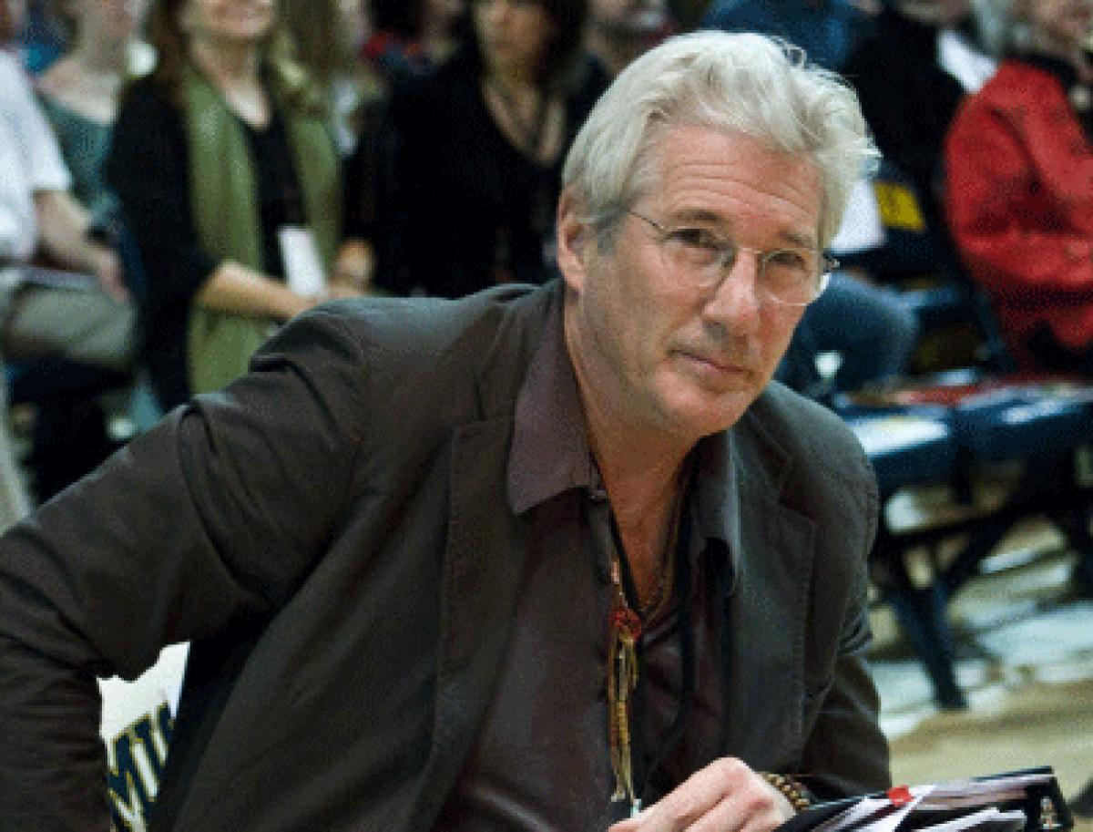 Richard Gere has filed a lawsuit alleging extortion of USD 500, 000 over the film rights to a book on Buddhism. AP file photo