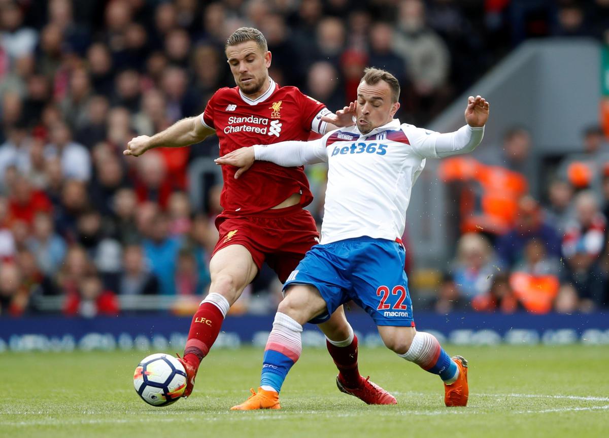 Stoke City's Xherdan Shaqiri (right) and Liverpool's Jordan Henderson vie for possession. Reuters