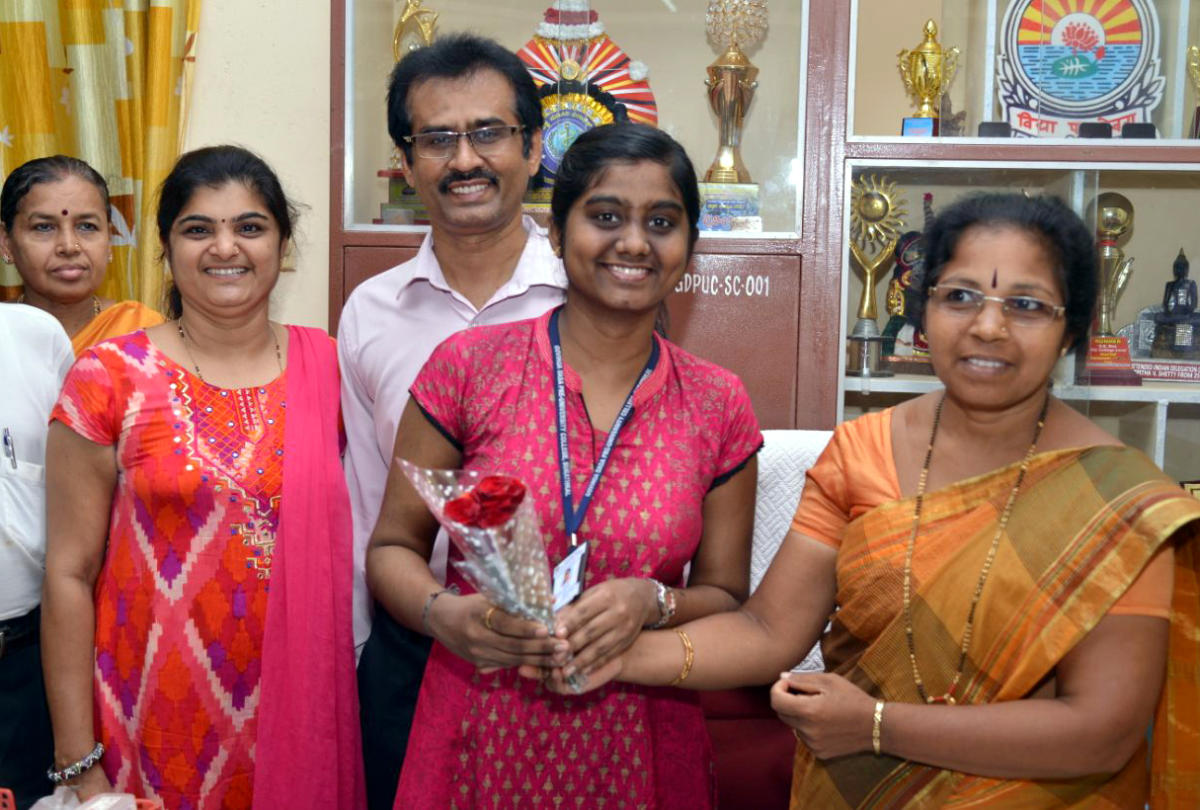 Ankitha being wished at Govinda Dasa College, Surathkal, for being the second topper in Science in the state.