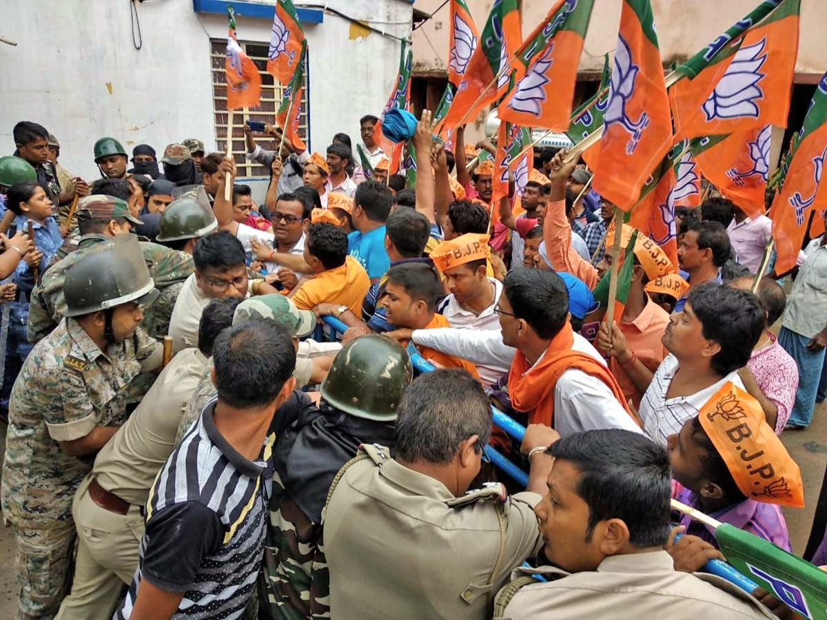 BJP leaders and activists raise slogans during a protest against the alleged unconstitutional situations throughout West Bengal, in front of Katwa Police station in Purba Bardhaman district on Friday, June 01, 2018. PTI Photo