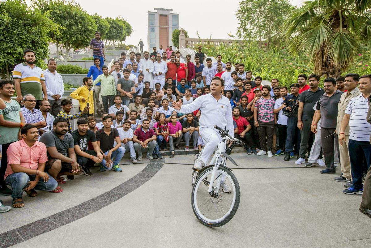 Former UP chief minister and Samajwadi Party President Akhilesh Yadav interacts with the people at Gomti River front, where he went for cycling, in Lucknow on Monday. (PTI Photo)