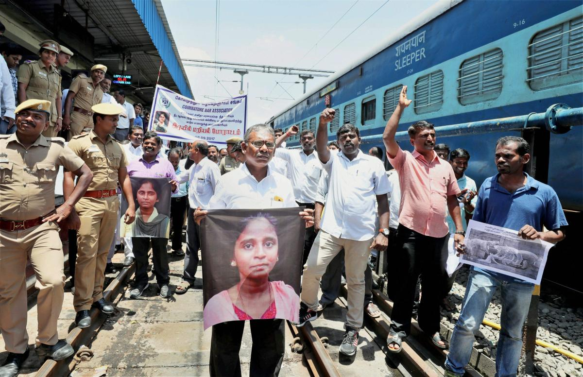 """Members of the Coimbatore Bar Association raise slogans during a """"rail roko"""" protest against NEET and demanding justice for the student S Anitha's death, in Coimbatore on Friday. PTI/FILE"""