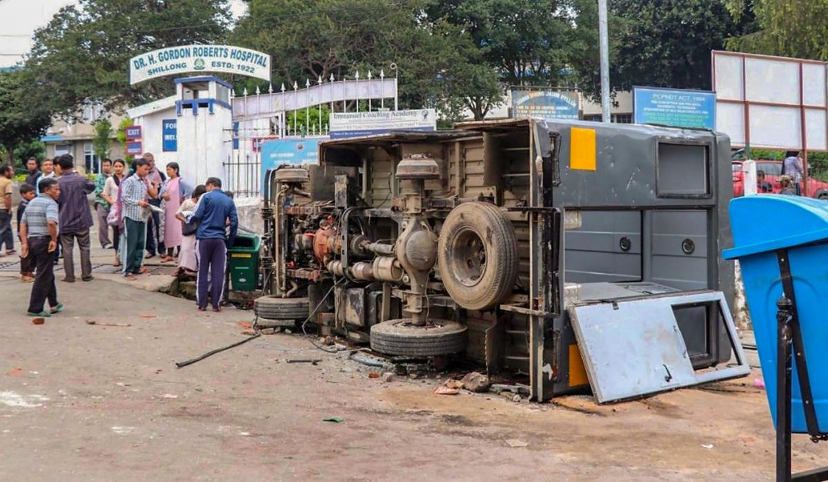 Shillong: A damaged UTI bus lies on a roadside after clashes between the residents of the city's Punjabi Line area and Khasi drivers of state-run buses, in Shillong on Monday, June 04, 2018. About 1,000 central paramilitary personnel have been sent to Meg