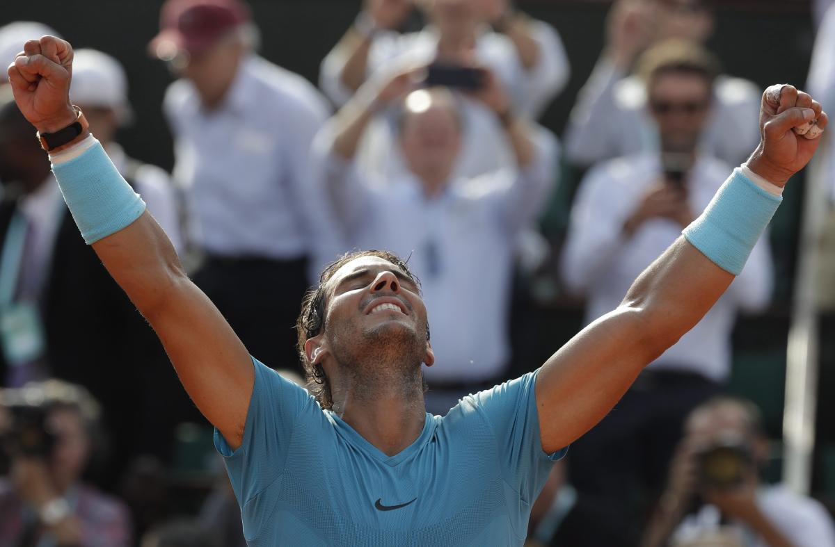 Spain's Rafael Nadal raises his arms after defeating Argentina's Juan Martin Del Potro during their semifinal match of the French Open tennis tournament at the Roland Garros stadium, Friday, June 8, 2018 in Paris. Nadal won 6-4, 6-1, 6-2. (AP/PTI Photo)