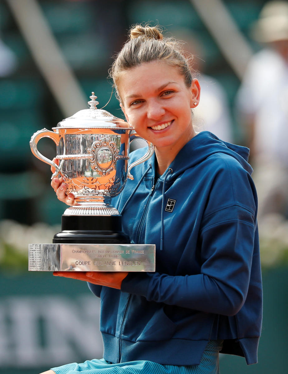 MOMENT TO SAVOUR Simona Halep was a much relieved player on Saturday after ending her Grand Slam final jinx. REUTERS