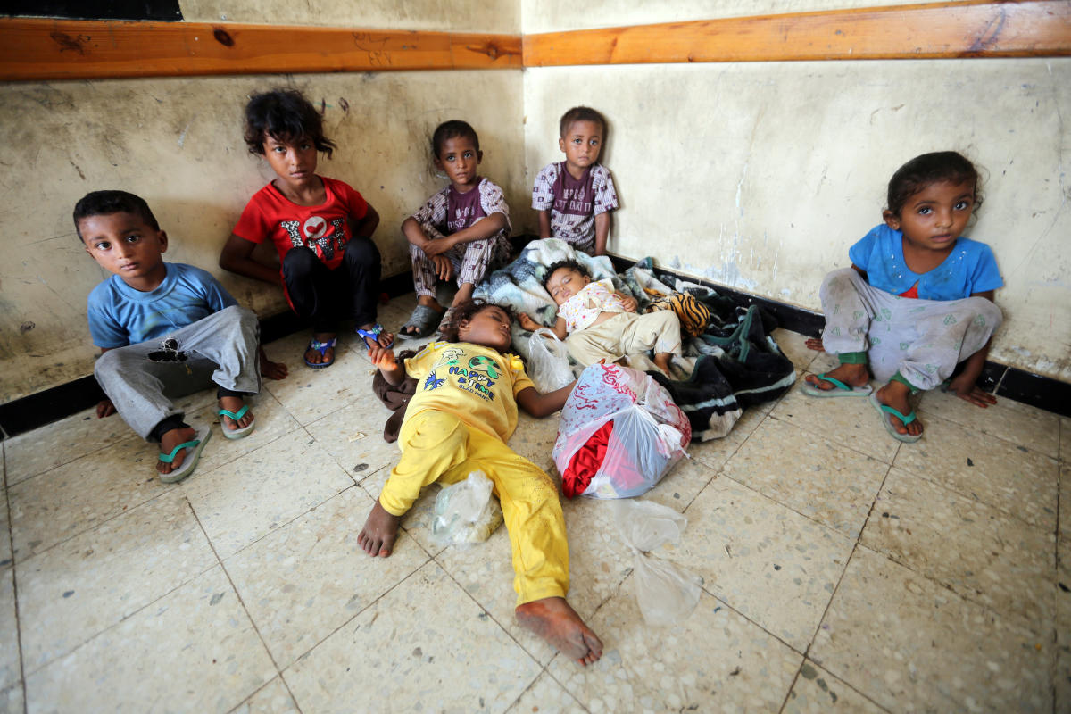 Children sit in a classroom of a school to which they have been evacuated from a village near Hodeidah airport amid fighting between government forces and Houthi fighters in Hodeidah, Yemen. (Reuters Photo)