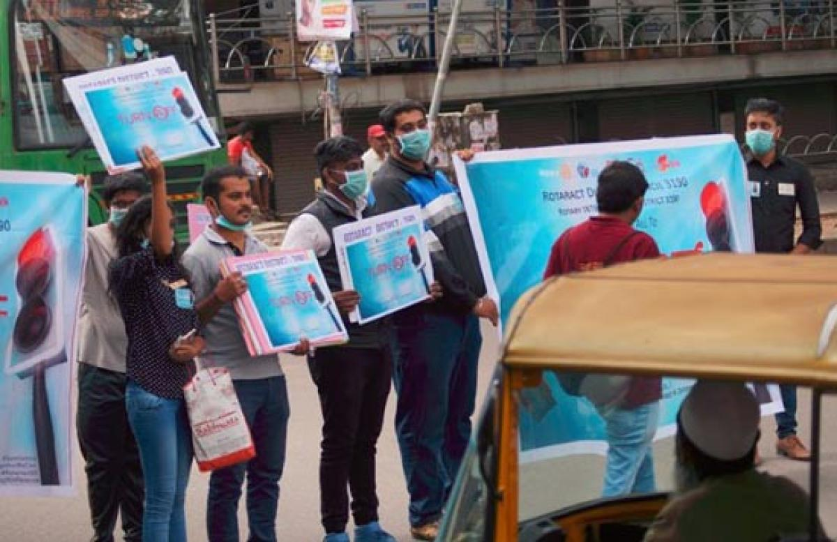 The members of the Rotaract club undertook a unique initiative to create awareness about switching off the vehicle engines at the traffic signal near KFC on CMH Road on Sunday.