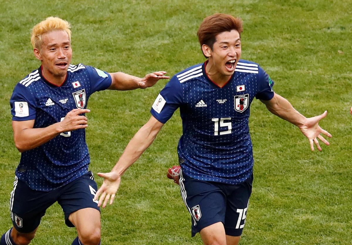 Japan's Yuya Osako celebrates scoring their second goal with Yuto Nagatomo. Reuters.